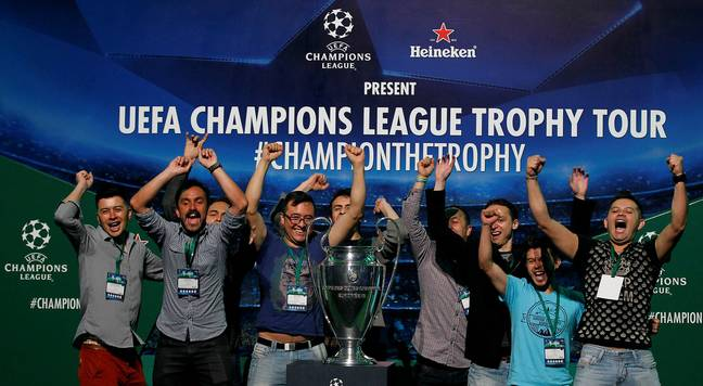 Fans having picture taken with Champions League trophy