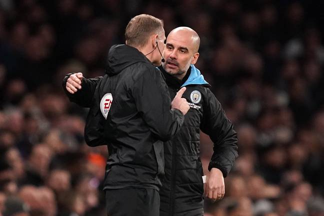 Guardiola discusses a referee decision with the fourth official. Image: PA Images