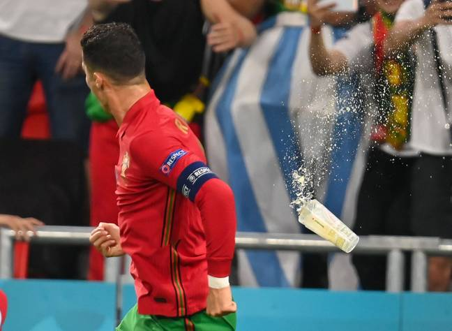Fans also threw cups of beer at Ronaldo. Credit: PA