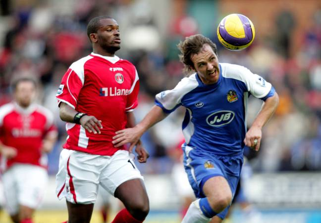 Andy Webster, right, playing for Wigan. Image: PA Images