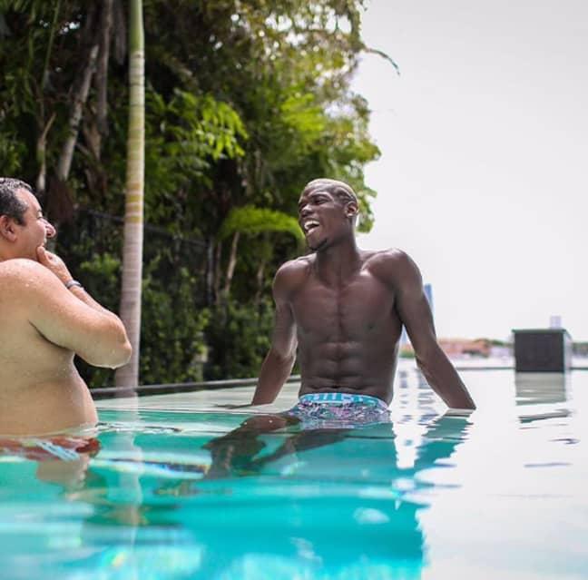 Raiola enjoys a swim with Pogba. Image: Instagram
