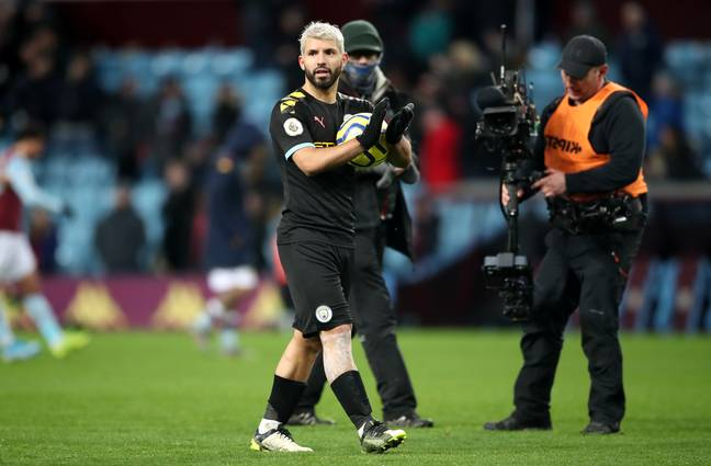 Aguero walks off with the match ball. Image: PA Images
