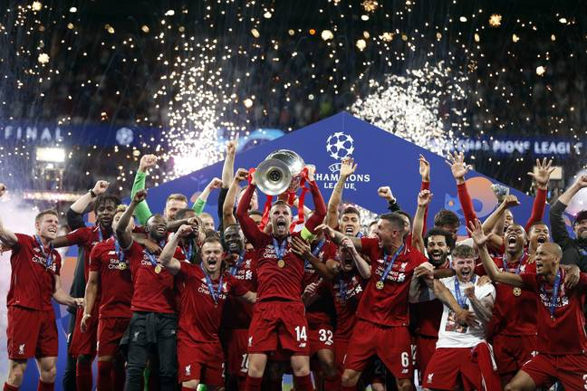 Liverpool players celebrate with their trophy. Image: PA Images