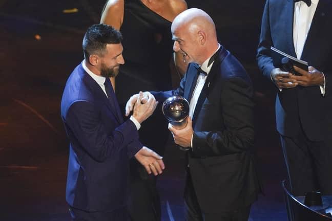 Messi receives his award. Image: PA Images