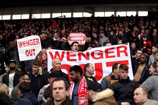 Wenger out signs started to follow the team everywhere. Image: PA Images