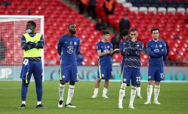 Chelsea players look on as Leicester celebrate their win. Image: PA Images
