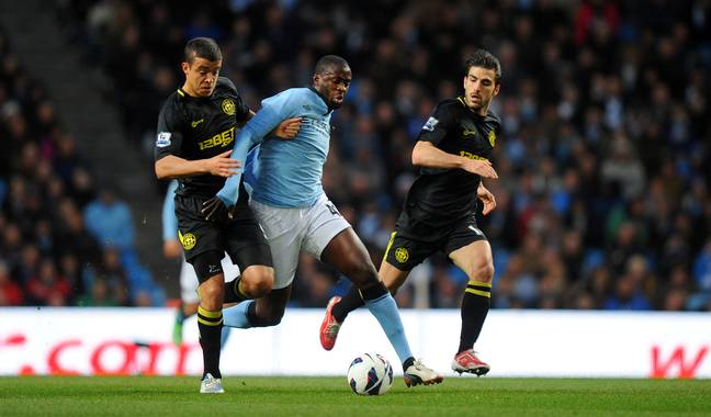 Toure gets his significant bum in the way of an opponent. Image: PA Images