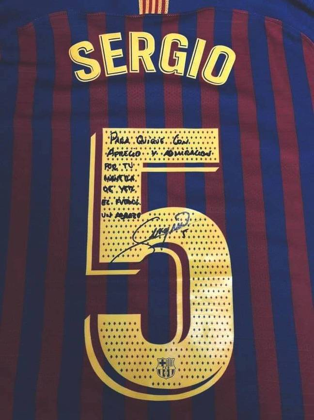 Sergio Busquets signed shirt.
