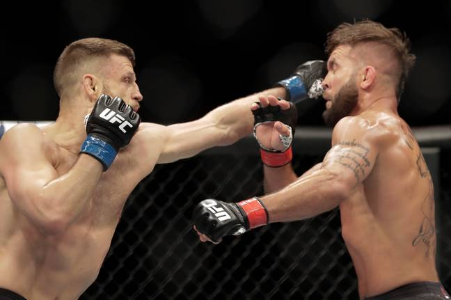 Calvin Kattar, left, strikes Jeremy Stephens, right, during their bout. (Image Credit: PA)