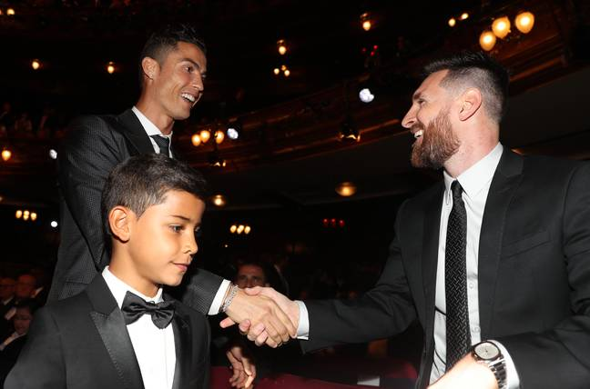 Ronaldo laughing because he doesn't agree with the results, Messi laughing because he does. Image: PA Images