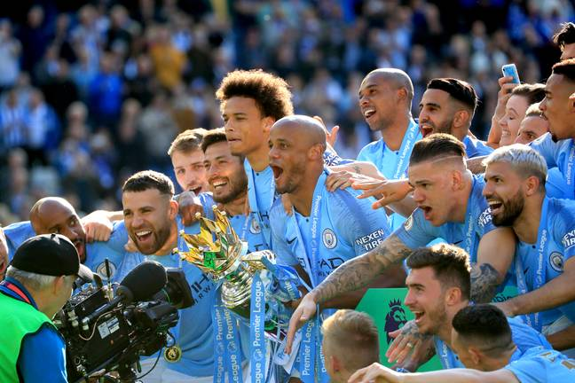 Kompany lifts his fourth Premier League title. Image: PA Images