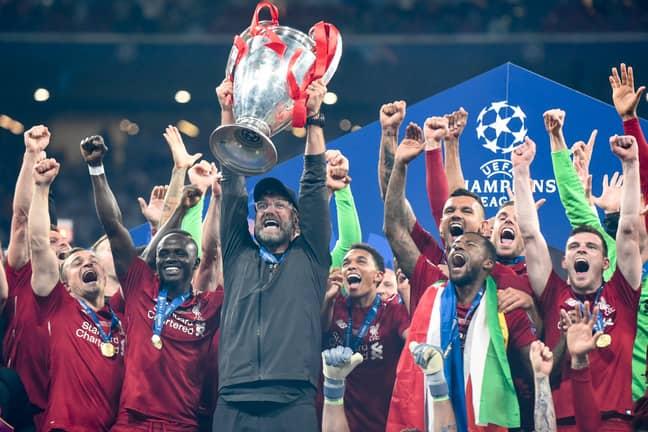 Jurgen Klopp lifts the Champions League trophy. Credit: PA