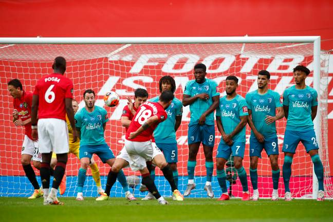 Fernandes curls in his free kick. Image: PA Images