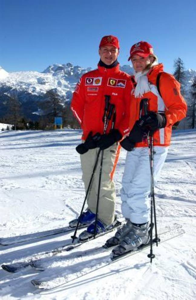 Michael Schumacher poses with his wife Corinna on a piste during the traditional three-day Ferrari meeting in Madonna di Campiglio. Credit: PA