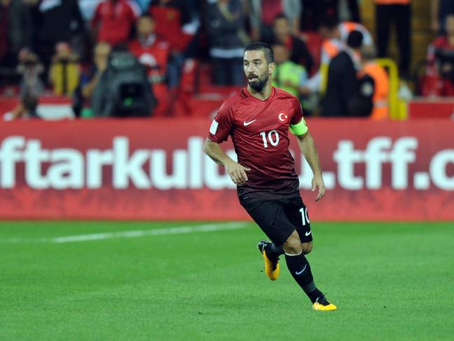 Turan in action for Turkey. Image: PA Images