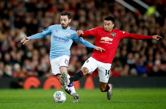 Lingard vs Silva during the game. Image: PA Images