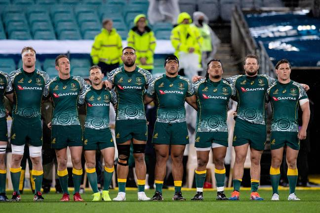 The Wallabies sing along to the anthem. Credit: PA