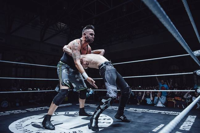 Dennis attacks his friend at Ally Pally. Image: The Head Drop/PROGRESS Wrestling