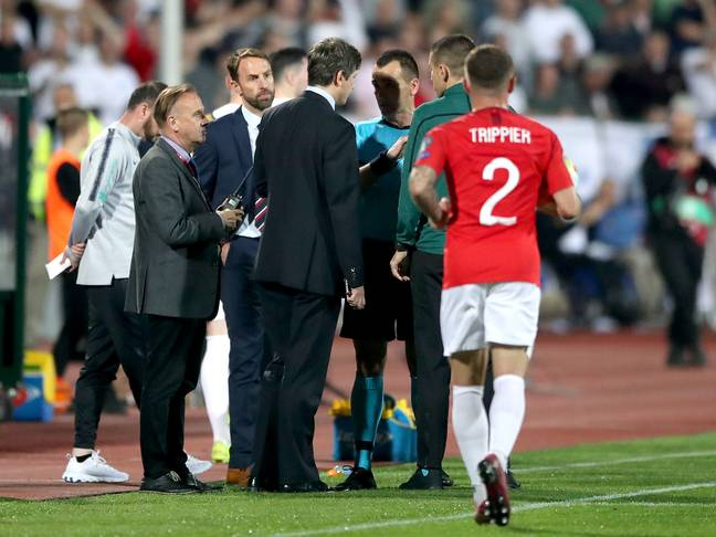 Gareth Southgate in conversation with the referee after the game was stopped. Image: PA Images
