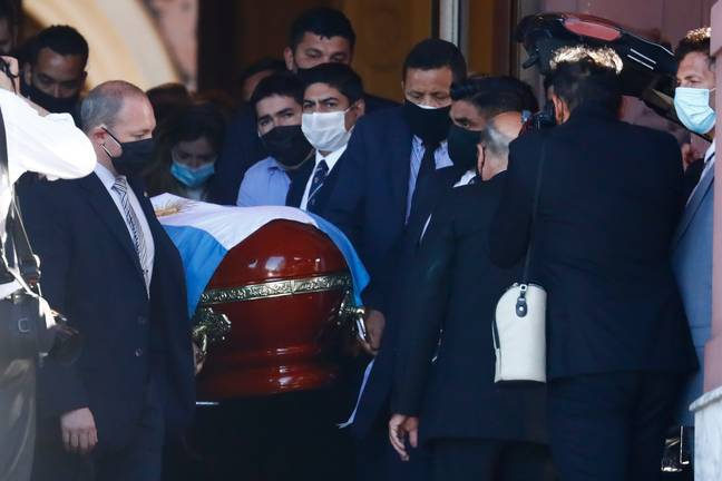 The flag-draped casket of Diego Maradona is carried to a waiting hearse after lying in state at the presidential palace in Buenos Aires, Argentina. Image: PA Images