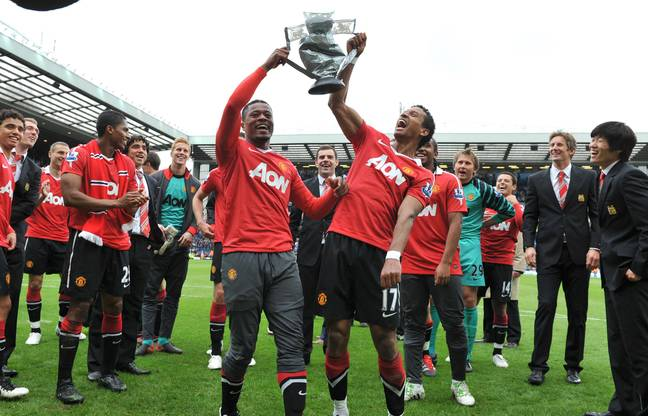 Evra celebrates with Nani and a fake Premier League trophy after the draw with Blackburn. Image: PA Images