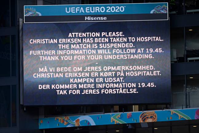 A video screen announces that Denmark's Christian Eriksen has been taken to hospital and the game is suspended. Credit: PA