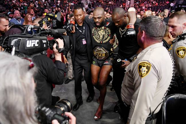Jones is carried out of the octagon following his fight with Thiago Santos. Credit: PA