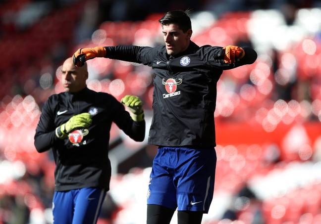 Courtois during the warm-up. Image: PA