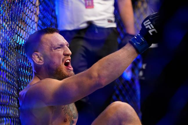 McGregor shouts at Poirier whilst sitting with his broken leg. Image: PA Images