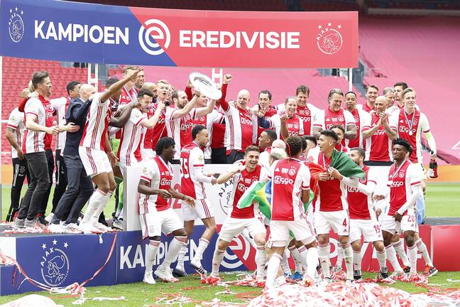 Ajax players celebrate their latest title win. Image: PA Images
