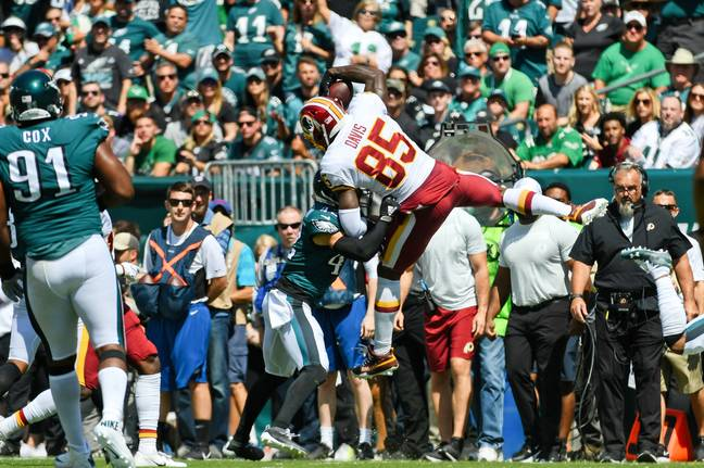 Vernon Davis leaped over an Eagles defender on his way to scoring a touchdown