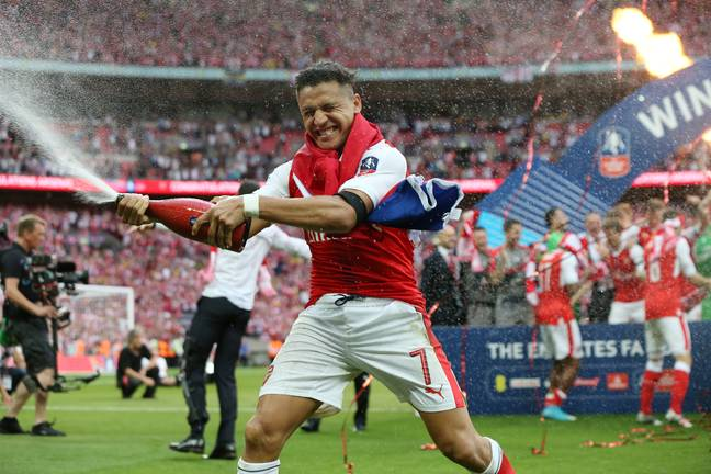 Things haven't been good for Sanchez at United. In happier times (bottom) winning the FA Cup with Arsenal. Images: PA Images