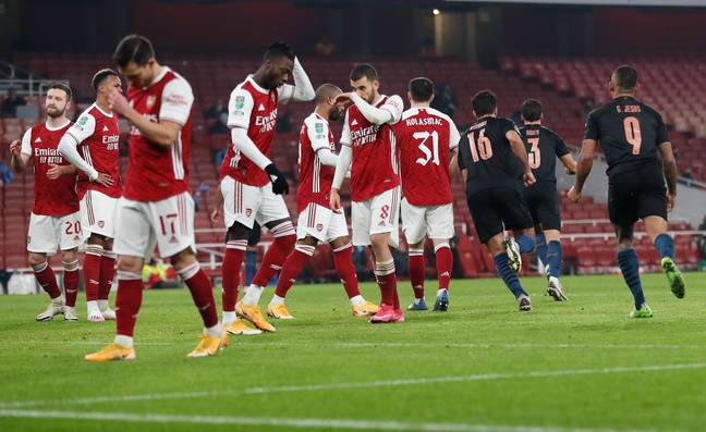 Arsenal players look dejected after Manchester City score in the Carabao Cup. Image: PA Images