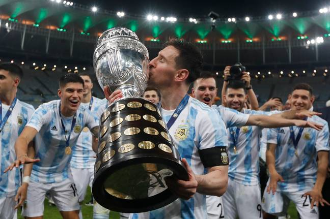 Messi gives the Copa America trophy a kiss. Image: PA Images