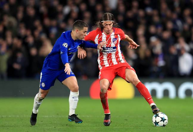 Hazard taking on Luis during a Champions League clash. (Image Credit: PA)