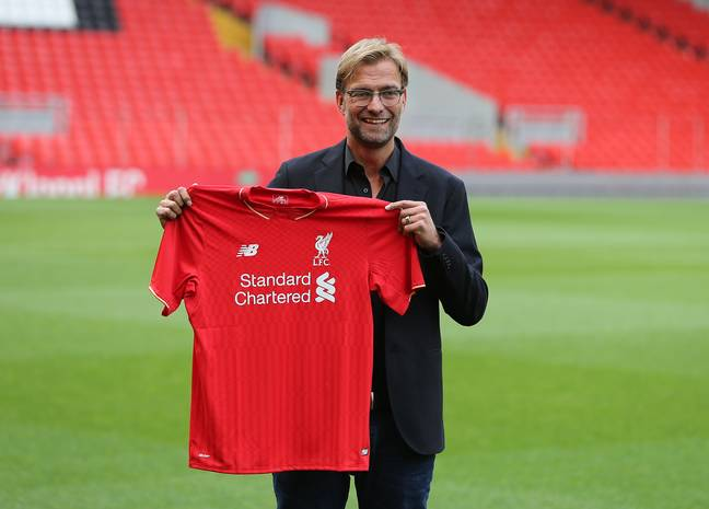 Klopp holding up his new shirt. Image: PA Images