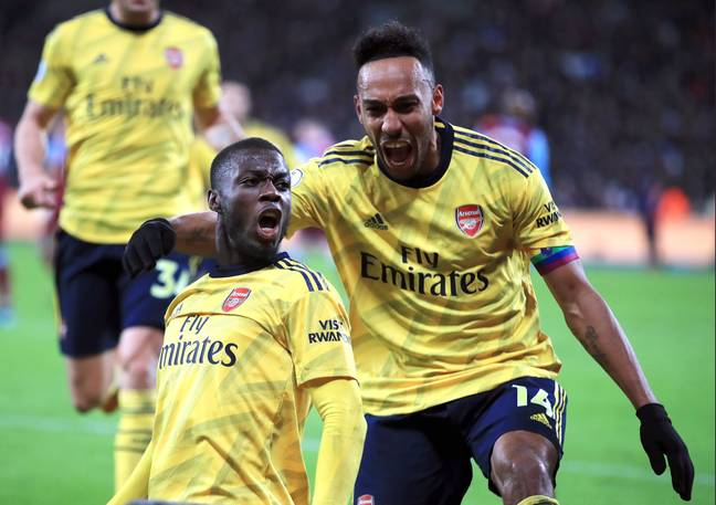Pepe (L) and Aubameyang (R) celebrate against West Ham last Monday. (Image Credit: PA)