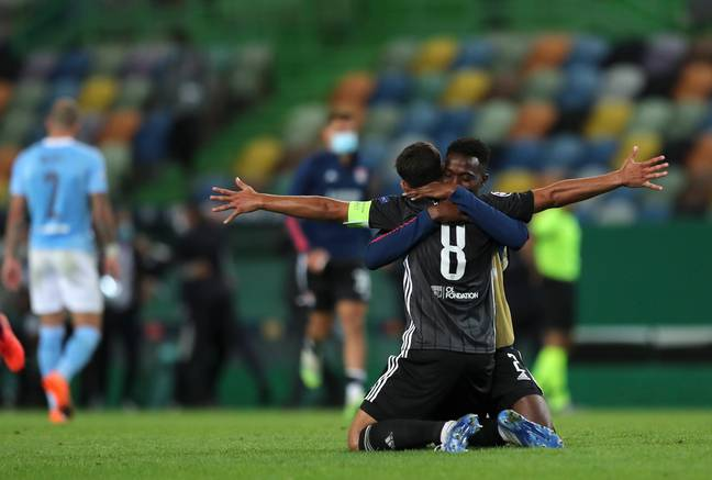 Lyon players celebrate at full time. Image: PA Images