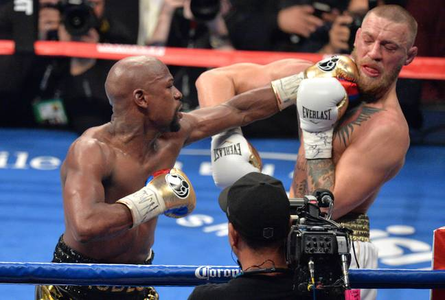 Mayweather lands a punch on McGregor during their 2017 boxing bout. Image: PA