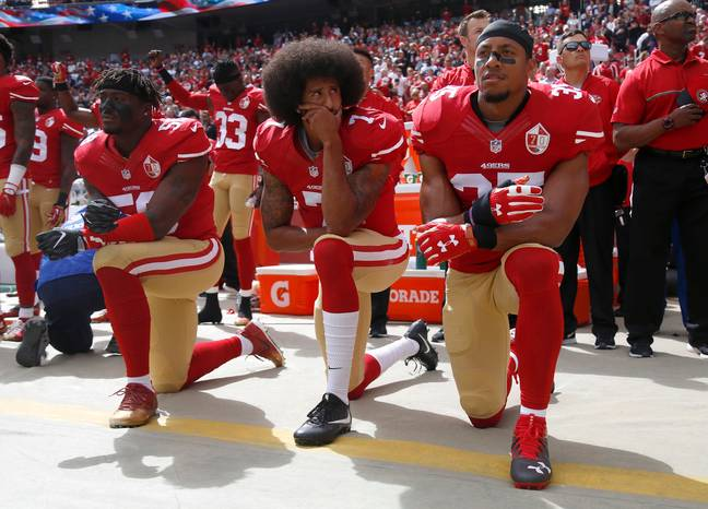 Colin Kaepernick and his teammates kneel in protest before an NFL game. Credit: PA