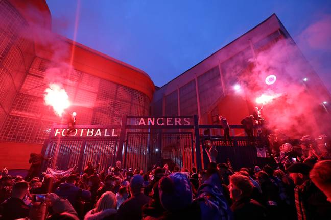 Rangers fans celebrate outside Ibrox. Image: PA Images