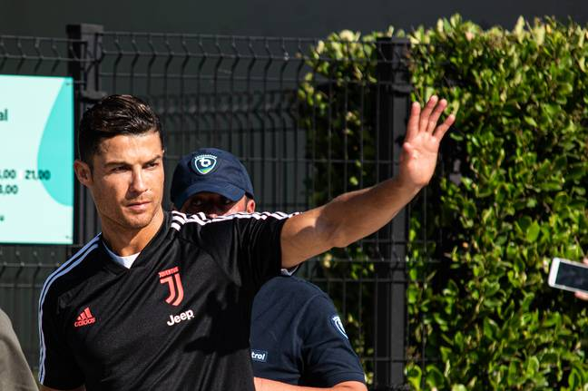 Ronaldo waves at the crowds ahead of pre season training. Image: PA Images