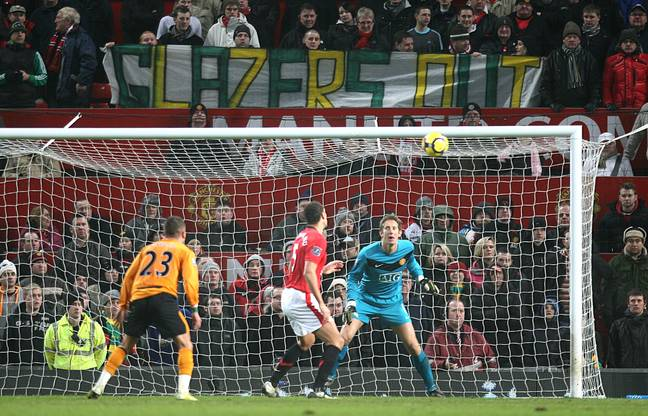 Banners in 2010, when United were champions. Image: PA Images