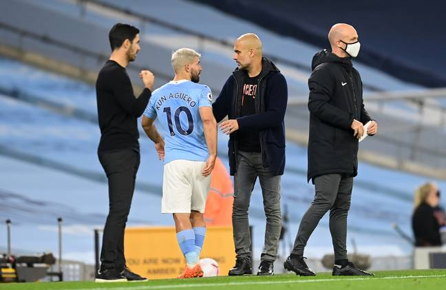 Guardiola talking to Aguero after substituting him off. Image: PA Images