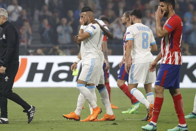 Payet leaves the field in tears. Image: PA
