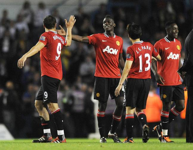 Pogba high fives his teammate after making his first team debut. Image: PA Images
