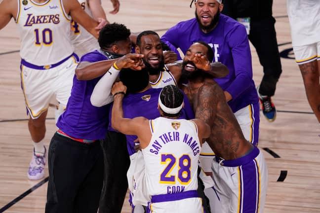 LeBron James celebrates with his Lakers teammates. Credit: PA