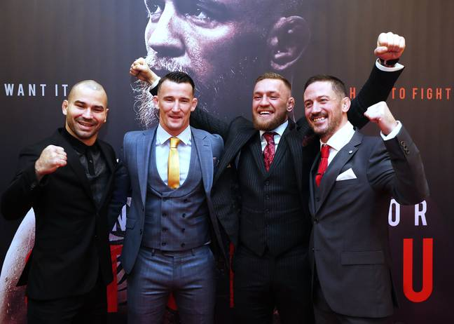 Conor McGregor with his training partner Artem Lobov (left), striking coach Owen Roddy (centre) and head coach John Kavanagh (right). Credit: PA