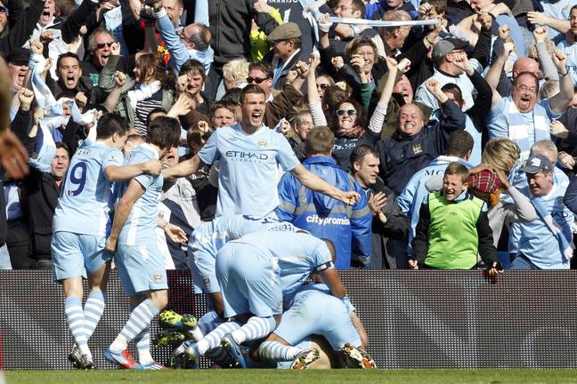 City players celebrate with Aguero. Image: PA Images