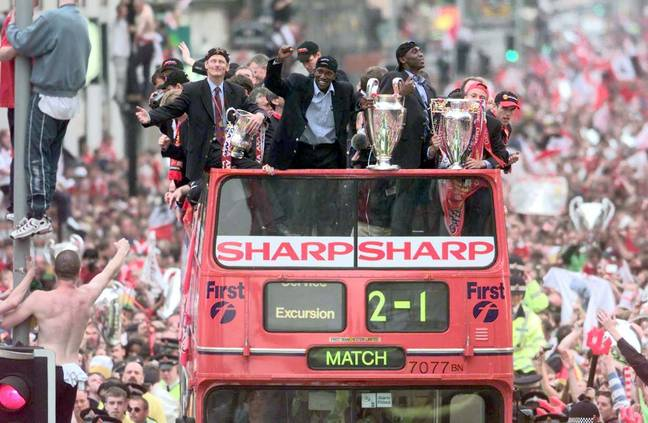 United players with all three trophies at the celebration parade. Image: PA Images